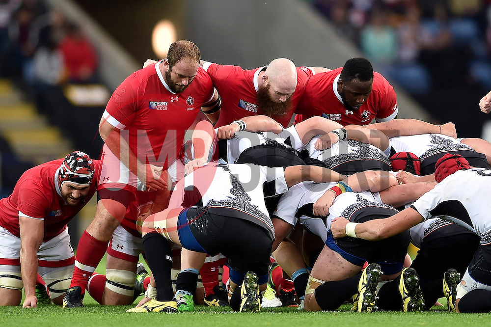 The Canada front row of Doug Wooldridge, Ray Barkwill and Djustice Sears-Duru pack down for a scrum - Mandatory byline: Patrick Khachfe/JMP - 07966 386802 - 06/10/2015 - RUGBY UNION - Leicester City Stadium - Leicester, England - Canada v Romania - Rugby World Cup 2015 Pool D.