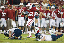 November 6, 2010; Stanford, CA, USA;  Stanford Cardinal running back Anthony Wilkerson (32) breaks a tackle from Arizona Wildcats linebacker Derek Earls (40) during the fourth quarter at Stanford Stadium.  Stanford defeated Arizona 42-17.
