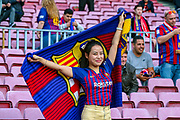 A Barcelona fan poses for a photograph ahead of the Champions League semi-final leg 1 of 2 match between Barcelona and Liverpool at Camp Nou, Barcelona, Spain on 1 May 2019.