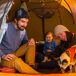 A young family in their tent on Lanes Island in Casco Bay. Yarmouth, Maine.