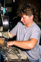 Women working with knife blanks in a cutlery factory in Sheffield ....