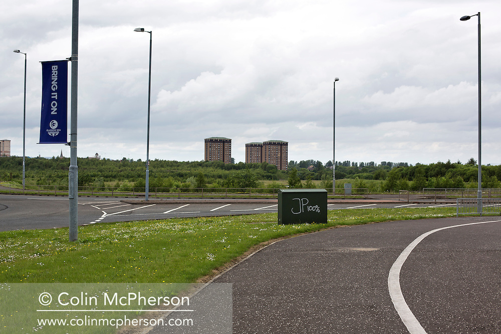 'Untitled, 2014' from the project 'The Fall and Rise of Ravenscraig' by photographer Colin McPherson.<br /> <br /> The photograph shows the New Craig Road, known as the 'spine road' constructed on the site of the former steelworks at Ravenscraig.<br /> <br /> This project, photographed in 2014, looks at the topography of the post-industrial landscape at Ravenscraig, the site until its closure in 1992 of the largest hot strip steel mill in western Europe. In its current state, Ravenscraig is one of the largest derelict sites in Europe measuring over 1,125 acres (4.55 km2) in size, an area equivalent to 700 football pitches or twice the size of Monaco. It is currently being developed with a mix of housing, retail and the home of South Lanarkshire College and the Ravenscraig Regional Sports Facility.