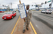 Henry Johnson holds up a sign while standing in the median at the intersection of Kansas Expressway and Division Street on Wednesday, March 22, 2017. Johnson said he was looking for work, not a hand out, and that someone gave him a business card and offered him an interview.