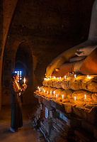 BAGAN, MYANMAR - CIRCA DECEMBER 2013: Pilgrim paying tribute to Buda in the Pahto Thamya Temple in Bagan