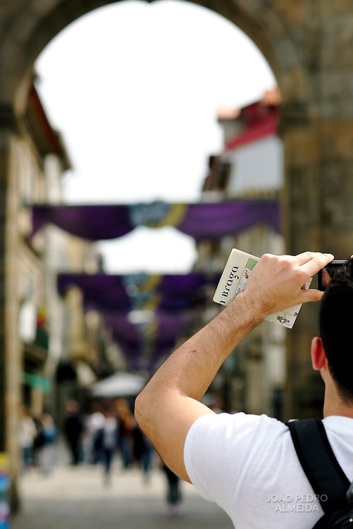 Tourist taking a photo close to Braga's Cathedral