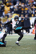 Jacksonville Jaguars kicker Josh Lambo (4) kicks a 45 yard field goal that gives the Jaguars a 45-35 lead on what turned out to be the game winning score late in the fourth quarter during the NFL 2018 AFC Divisional playoff football game against the Pittsburgh Steelers, Sunday, Jan. 14, 2018 in Pittsburgh. The Jaguars won the game 45-42. (©Paul Anthony Spinelli)