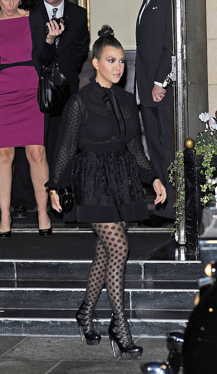 08.NOVEMBER.2012. LONDON<br /> <br /> KIM AND KOURTNEY KARDASHIAN LEAVING THEIR LONDON HOTEL TO HEAD TO AQUA BAR FOR THE KARDASHIAN COLLECTION LAUNCH PARTY.<br /> <br /> BYLINE: EDBIMAGEARCHIVE.CO.UK<br /> <br /> *THIS IMAGE IS STRICTLY FOR UK NEWSPAPERS AND MAGAZINES ONLY*<br /> *FOR WORLD WIDE SALES AND WEB USE PLEASE CONTACT EDBIMAGEARCHIVE - 0208 954 5968*