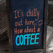 Bloard humorous  outdoor sign. <br /> <br /> &quot;It's chilly out here... How about a COFFEE&quot;<br /> <br /> BIRCH coffee on 7th Ave, NYC
