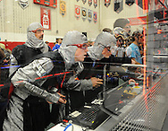 Hatboro Horsham's (L-R) John Piergallini, Pat Ehrgutt and Chris Morgan control their robot during the 2016 First Mid-Atlantic First Robotics Competition at Hatboro Horsham High School Saturday March 5, 2016 in Horsham, Pennsylvania. (Photo by William Thomas Cain)