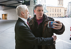 © Licensed to London News Pictures. 13/11/2016. London, UK. Leader of the Labour Party Jeremy Corbyn MP prepares to have a selfie taken as he arrives at the Andrew Marr Show today. The show has been heavily criticised for screening a pre-recorded interview with far-right politician Marine Le Pen, who associates with Le Front National (The National Front). Photo credit : Tom Nicholson/LNP