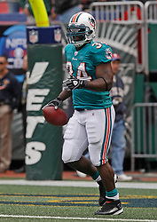 Nov 1, 2009; East Rutherford, NJ, USA; Miami Dolphins running back Ricky Williams (34) during the pregame warmup for of their game against the New York Jets at Giants Stadium. Mandatory Credit: Ed Mulholland