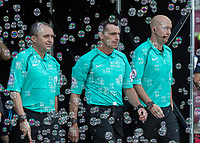 Football - 2016 / 2017 Premier League - West Ham United vs. Middesborough <br /> <br /> Referee Neil Swarbrick emerges with his team through the bubbles at The London Stadium.<br /> <br /> COLORSPORT/DANIEL BEARHAM