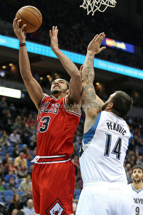 Nov 1, 2014; Minneapolis, MN, USA; Chicago Bulls forward Joakim Noah (13) shoots over Minnesota Timberwolves center Nikola Pekovic (14) during the first quarter at Target Center. Mandatory Credit: Brace Hemmelgarn-USA TODAY Sports