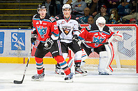 KELOWNA, CANADA, OCTOBER 20: MacKenzie Johnston #22 and Adam Brown #1 of the Kelowna Rockets defend as  the Vancouver Giants visited the Kelowna Rockets on October 20, 2011 at Prospera Place in Kelowna, British Columbia, Canada (Photo by Marissa Baecker/shootthebreeze.ca) *** Local Caption *** MacKenzie Johnston; Adam Brown;