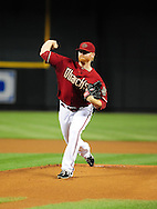 Apr. 17 2011; Phoenix, AZ, USA; Arizona Diamondbacks starting pitcher .Barry Enright (54) pitches during the first inning against the San Francisco Giants at Chase Field. Mandatory Credit: Jennifer Stewart-US PRESSWIRE