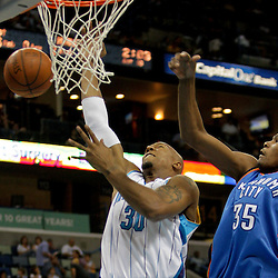 Oct 10, 2009; New Orleans, LA, USA;  Oklahoma City Thunder forward Kevin Durant (35) fouls New Orleans Hornets forward David West (30) on a shot in the second quarter at the New Orleans Arena. Mandatory Credit: Derick E. Hingle-US PRESSWIRE