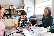 Milano, Italia - Leonardo, 18 anni, insieme a Stefania Murra (a sinistra la mamma), suo angelo custode ed educatrice all'interno dell'Istituto Benedetta D'Intino a Milano.<br /> Ph. Roberto Salomone