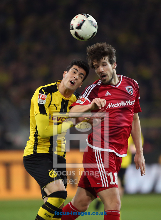 Marc Bartra of Borussia Dortmund and Pascal Gross of FC Ingolstadt 04 during the Bundesliga match at Signal Iduna Park, Dortmund<br /> Picture by EXPA Pictures/Focus Images Ltd 07814482222<br /> 17/03/2017<br /> *** UK &amp; IRELAND ONLY ***<br /> EXPA-EIB-170318-0058.jpg