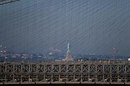 New York. Statue of liberty and the Brooklyn bridge   /  La statue de la liberte et le pont de Brooklyn  New York  USa