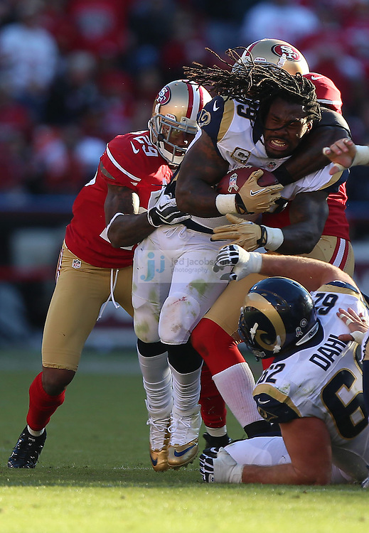 St. Louis Rams running back Steven Jackson (39) is tackled by San Francisco 49ers cornerback Chris Culliver (29) and linebacker Patrick Willis (52) after losing his helmet, Sunday, Nov. 11, 2012 at Candlestick Park, in San Francisco, Ca. (AP Photo/Jed Jacobsohn)