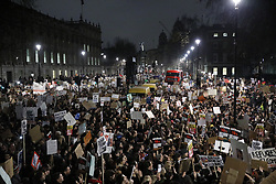 © Licensed to London News Pictures. 30/01/2017. London, UK. Demonstrators gather in Whitehall to protest about US President Trump's travel ban. Thousands of people are gathering in cities throughout the UK.  Photo credit: Peter Macdiarmid/LNP
