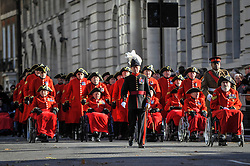 © Licensed to London News Pictures. 12/11/2017. London, UK.  Chelsea Pensioners parade on their way to Horse Guards parade on Remembrance Sunday where members of the Royal Family, dignatories and veterans gave tributes to war dead at The Cenotaph.  Photo credit: Stephen Chung/LNP