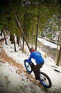Mountain biking on snow in winter using fat bikes snow bikes on Marquette Michigan's South Trails.