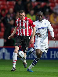 SHEFFIELD, ENGLAND - Saturday, March 17, 2012: Tranmere Rovers' Enoch Showunmi in action against Sheffield United's Neill Collins during the Football League One match at Bramall Lane. (Pic by David Rawcliffe/Propaganda)