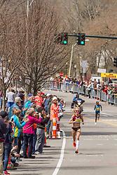 2014 Boston Marathon: lead pack of elite women race passes mile 19 in the Newton Hills, Shalane Flanagan on Heartbreak Hill