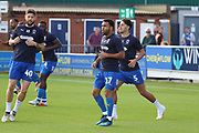 AFC Wimbledon striker Andy Barcham (17), AFC Wimbledon midfielder Anthony Wordsworth (40) and AFC Wimbledon defender Will Nightingale (5) warming up during the EFL Sky Bet League 1 match between AFC Wimbledon and Scunthorpe United at the Cherry Red Records Stadium, Kingston, England on 15 September 2018.