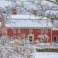 New England winter photography of the Longfellow's Wayside Inn at the Wayside Inn Historic District. This local New England landmark is in Sudbury, Massachusetts. <br />