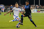 March 2, 2019; San Jose, CA, USA; Montreal Impact forward Maximiliano Urruti (37) and San Jose Earthquakes defender Marcos Lopez (27) fight for the ball during the second half at Avaya Stadium.