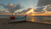 Beached fishingboat at sunset On the beach near Acre, Israel