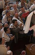 Tehran, Iran. October 1, 2007- Men read the Torah aloud together as part of Sukkot ceremony in Youseabad Synagogue.