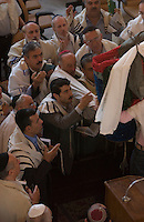 Tehran, Iran. October 1, 2007- Men read the Torah aloud together as part of Sukkot ceremony in Youseabad Synagogue.