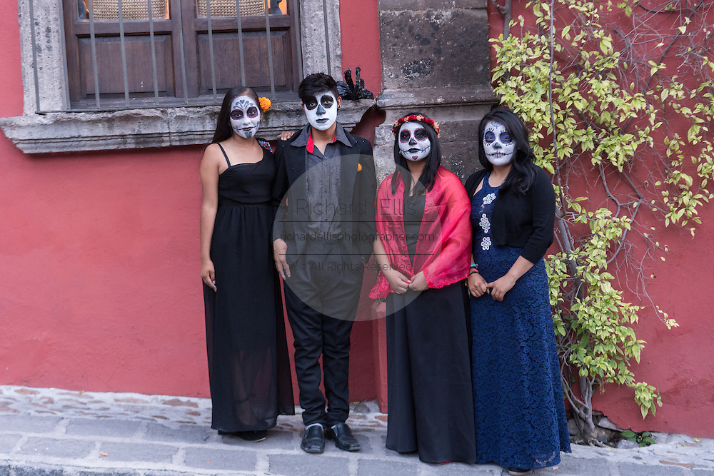 Young people dressed as La Calavera Catrina and the dapper skeleton for Day of the Dead festival in San Miguel de Allende, Guanajuato, Mexico. The week-long celebration is a time when Mexicans welcome the dead back to earth for a visit and celebrate life.