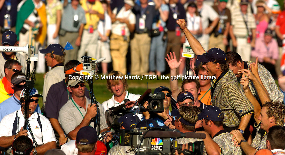 Winning captain Bernhard LANGER (EUR) celebrates a sweet victory over team USA 18.5 points to 9.5 as he is lifted by his team onto their shoulders and salutes the European fans during final day Singles of the Ryder Cup Matches 2004,Oakland Hills (South Course),Bloomfield,Michigan,USA.