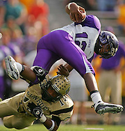 Lufkin quarterback Jeffrey Claybon (12) is tackled by Conroe's D.D. Johnson during Lufkin's 30-9 victory Saturday, November 10, 2007 at Moorehead Stadium in Conroe, TX.