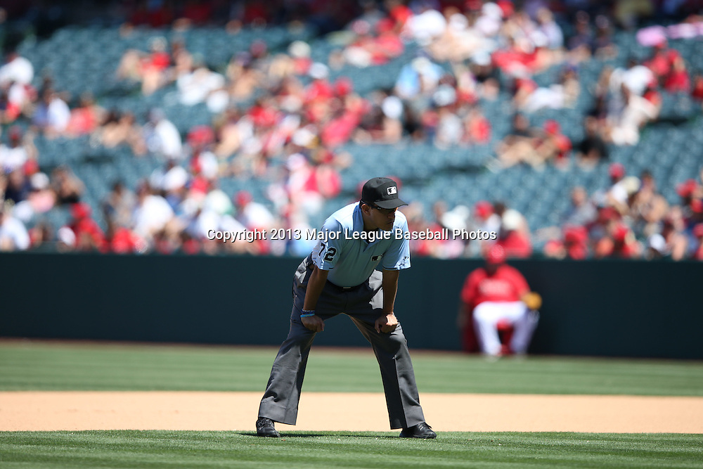 ANAHEIM, CA - JULY 24:  Second base umpire Alfonso Marquez #72 looks on during the Los Angeles Angels of Anaheim game against the Minnesota Twins on Wednesday, July 24, 2013 at Angel Stadium in Anaheim, California. The Angels won the game in a 1-0 shutout. (Photo by Paul Spinelli/MLB Photos via Getty Images) *** Local Caption *** Alfonso Marquez