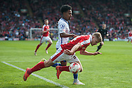Lloyd Isgrove of Barnsley goes down under a challenge from Rico Henry of Walsall during the Sky Bet League 1 Playoff Semi Final First Leg at Oakwell, Barnsley<br /> Picture by Matt Wilkinson/Focus Images Ltd 07814 960751<br /> 14/05/2016