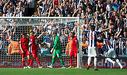WEST BROMWICH, ENGLAND - Saturday, August 18, 2012: Liverpool's Joe Allen, Martin Skrtel, goalkeeper Jose Reina and Glen Johnson look dejected as West Bromwich Albion score the third goal during the opening Premiership match of the season at the Hawthorns. (Pic by David Rawcliffe/Propaganda)
