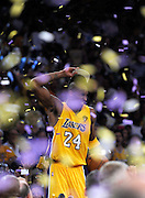 Kobe Celebrates while the confetti falls, after he stands on top of the scorers table at the end of the game. The Lakers defeated the Boston Celtics in game 7 of the NBA Finals  83-79 in Los Angeles, CA 06/16/2010 (John McCoy/Staff Photographer).