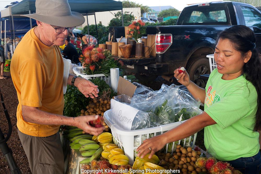 HI00442-00...HAWAI'I - Fruit at Honoka'a Saturday Market along the Hamakua Coast on the island of Hawai'i.