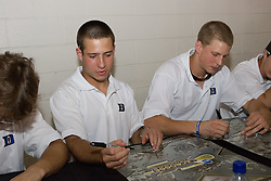27 May 2007: Duke Blue Devils midfielder Michael Young (27) and defenseman Jay Jennison (49) sign autographs at M&T Bank Stadium in Baltimore, MD.