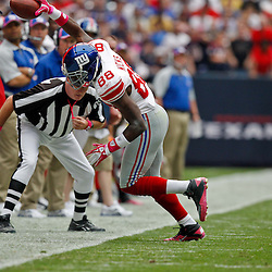 October 10, 2010; Houston, TX USA; New York Giants wide receiver Hakeem Nicks (88) stays in bounds on a catch against the Houston Texans during the first half at Reliant Stadium. Mandatory Credit: Derick E. Hingle