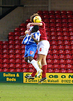 Photo: Dave Linney.<br />Walsall v Hartlepool United. Coca Cola League 1. 17/12/2005.Dean McDonald (Hartlepool) is beaton to the header by  Ian Roper(Walsall)
