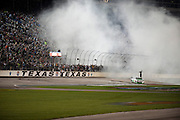 Kyle Busch (18) in the Interstate Batteries Toyota celebrates after winning the Sprint Cup NRA 500 at Texas Motor Speedway in Fort Worth on Saturday, April 13, 2013. (Cooper Neill/The Dallas Morning News)