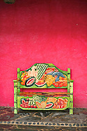 Pink wall and a colorful fruit bench in Cabo San Lucas, Baja California Sur, Mexico
