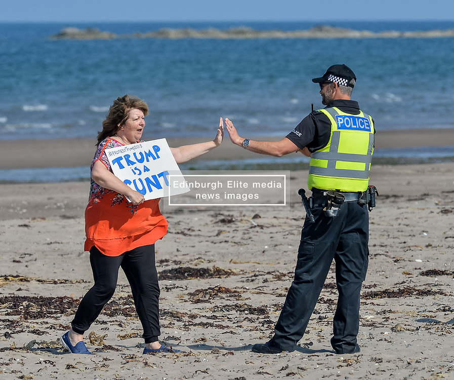 Pictured: Scottish comedian and activist Janey Godley led the protests, with a sign saying 'Trump's a runt'<br /> <br /> Protesters gathered amid tight security at the Trump Turnberry resort, where President Trump and his wife Melania are staying on their trip to Scotland.<br /> <br /> © Dave Johnston / EEm