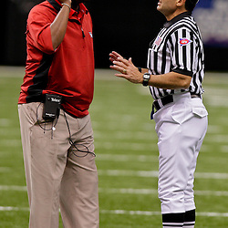 Oct 17, 2009; New Orleans, LA, USA; Houston Cougars head coach Kevin Sumlin talks to an official on the field during the second half against the Tulane Green Wave at the Louisiana Superdome. Houston defeated Tulane 44-16. Mandatory Credit: Derick E. Hingle-US PRESSWIRE